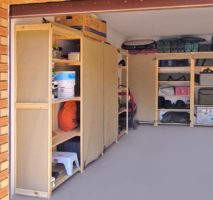 Image of a neat and tidy garage after we installed our garage shelving. The garage shelving in this picture is combined with our canvas covers
