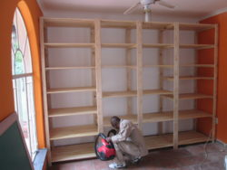 Our shelving works perfectly in Walk in Closets, This room has been transformed into a walk in closet and the shelves were made to fit wall to wall