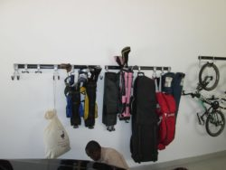 This image shows 3 hook and rail systems used to hang a variety of items, including golf bag, bicycle and bags