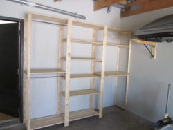 On this garage shelves we have installed hanging rods for jackets