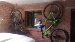 Using our single hook rail these two bikes are hanged vertically in the garage.