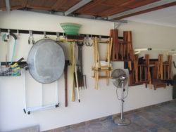 This is how this garage looks after we installed our garage shelving and hook and rails - Messy!