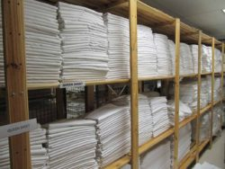 Image of linen packed on shelves. Our shelving is perfect for linen storage. The shelves allows for airflow to prevent mouldy smells