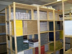 Image of storeroom shelves. The shelves in this image contains books and stationary in corporate storeroom. Files and Books neatly packed on Shef Space Storeroom shelving system.