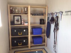 Our shelving used in combination with our hook and rail systems organises this tackroom beautifully