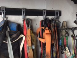 Another image of how our hook and rail systems are used in garage to hang a variety of items. Ladders, Garden utensils and more. Everything neatly and off the floor.