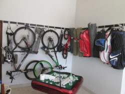 Another classic example of how our hook and rail systems are used in a garage, This On this image you see a few golf bags and bicycles, neatly out of the way and off the floor