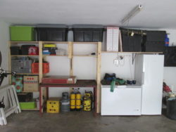 This is how this garage looks after we installed our garage shelving and hook and rails - Neat and Tidy - Transformed