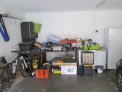 This is how this garage looked before we installed our garage shelving and hook and rails - Messy!