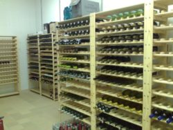 Image of wine racks. Our shelving has adjustable shelve heights. Our wine rack shelving stores wine bottles vertically on shelves to keep the cork wet. Our shelving is strong enough to comfortable carry more items in boxes above the shelves