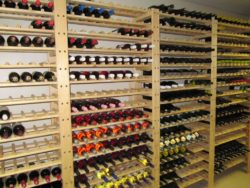 Image of wine racks. Our shelving has adjustable shelve heights. Our wine rack shelving stores wine bottles vertically on shelves to keep the cork wet.
