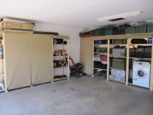 Garage shelving used in this garage speaks of order and tidiness