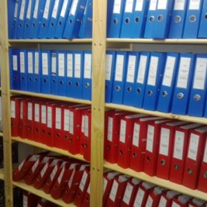 Image of files on storeroom shelf. This filing storeroom shelving unit has been customised to include as much as pssible files on one shelf without loosing capacity.