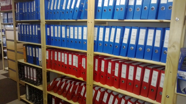 Image of files on storeroom shelf. This filing storeroom shelv has been customised to include as much as pssible files on one shelf without loosing capacity.