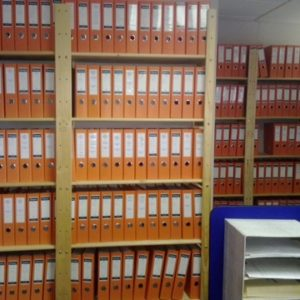 Image of files on storeroom shelf. This filing storeroom shelving unit has been customised to include as much as possible files on one shelf without loosing capacity.