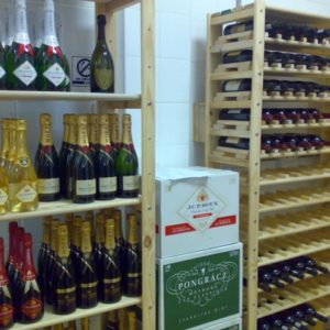 Our shelving units are perfcet for liquor stores, this image shows wine bottles and boxes on shelving unit in liquor store