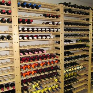 Image of pivot wine racks were bottles lies vertically on shelves to keep the cork wet